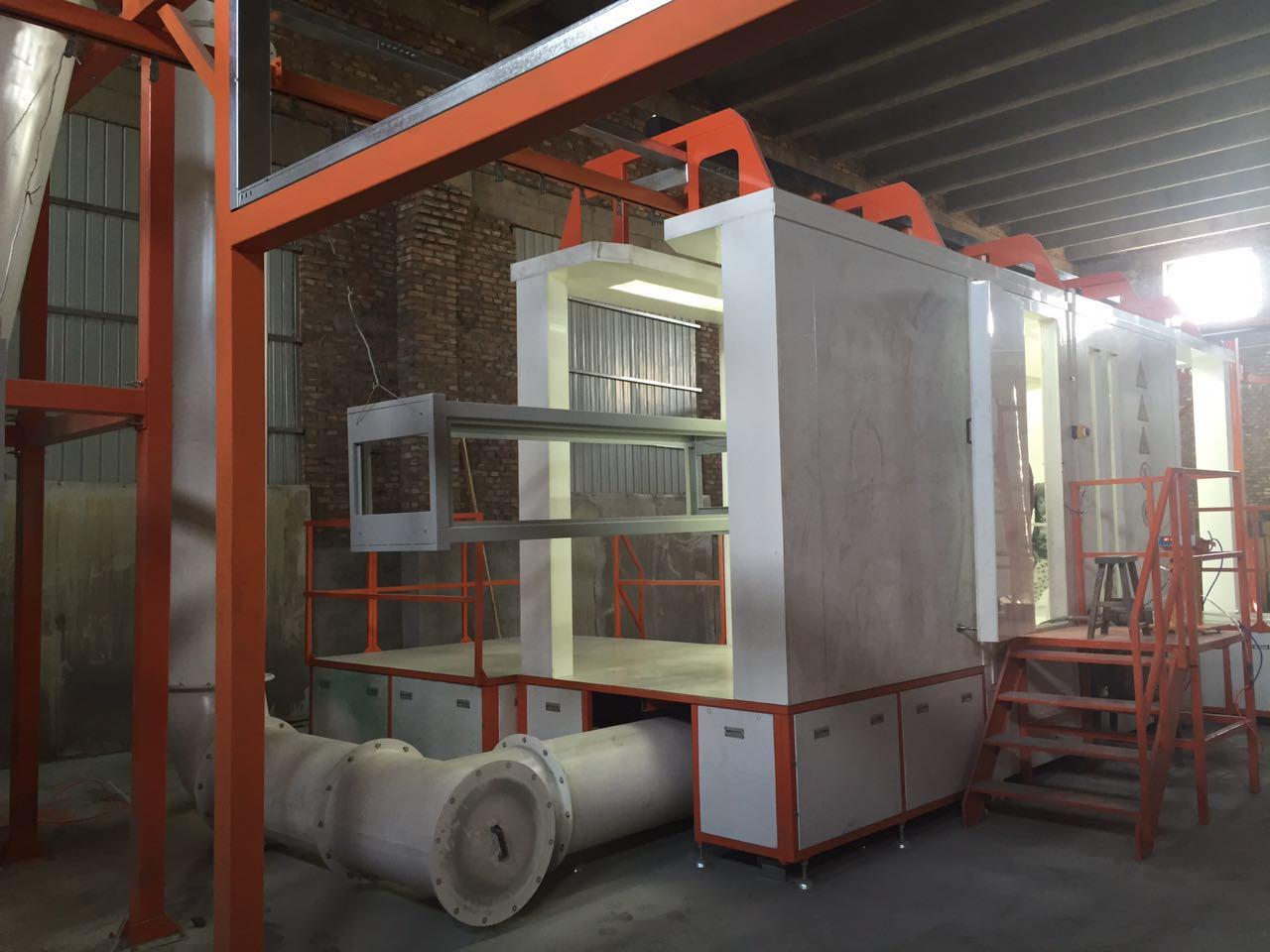 Powder spraying chamber (7)